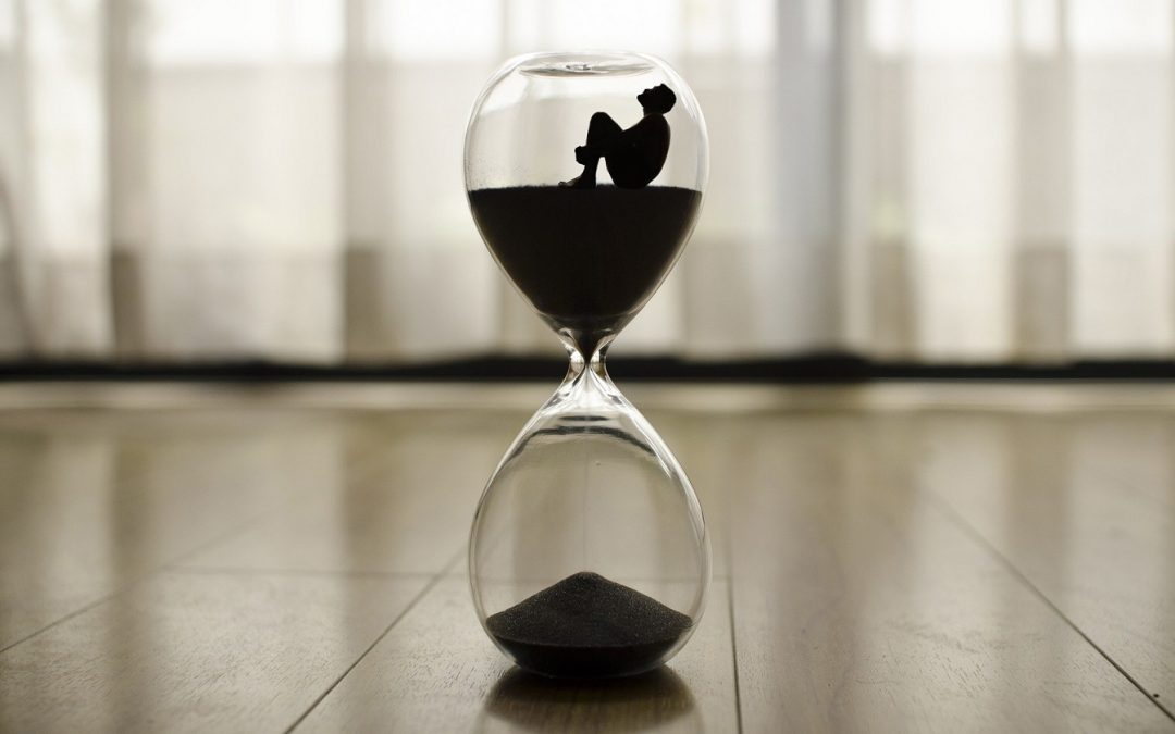 man trapped inside an hourglass