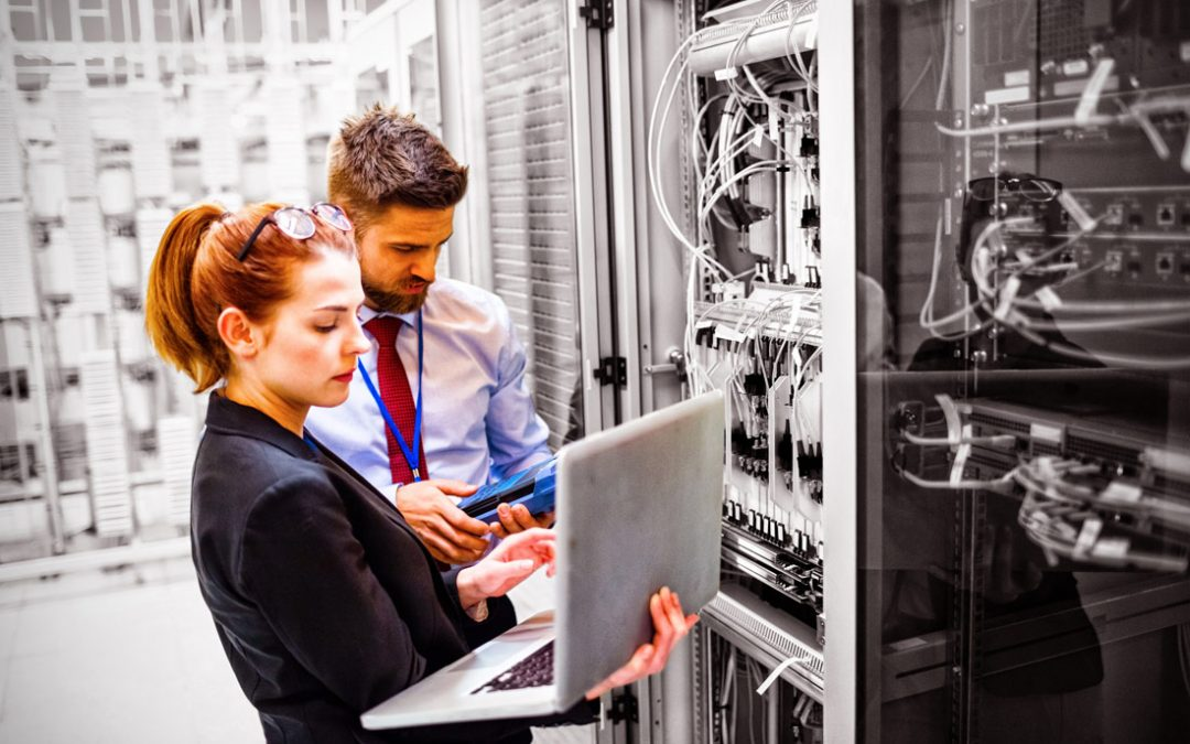 man and woman near a physical database